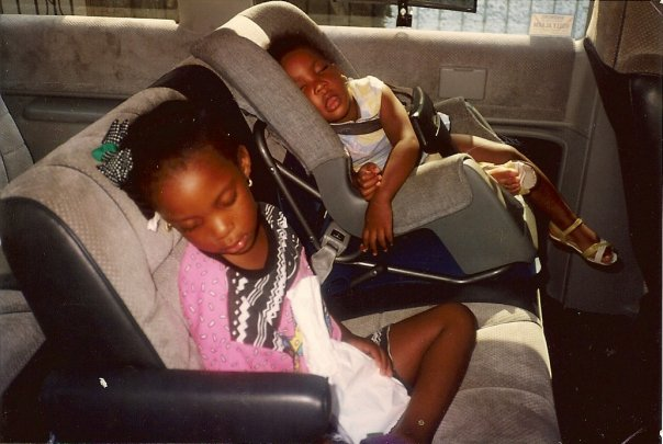 I'm the big one in this picture. Kendra is in the carseat with her original brows.